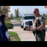 Sergeant Justin Montover speaks with a person