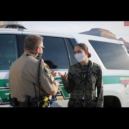 Women speaks with deputy