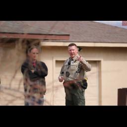 Deputy speaks with a neighbor