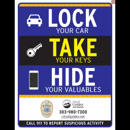 "This is an image of a sign stating ""Lock your vehicle, Take your keys, Hide your valuables"""