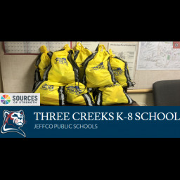 This is an image of bags with supplies donated by Three Creeks K-8.