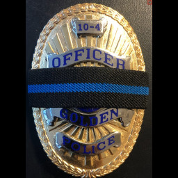 This is an image of the Golden Police Department's Badge with a thin blue line.