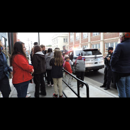 HTA students take a look at Corporal Tebedo's police vehicle