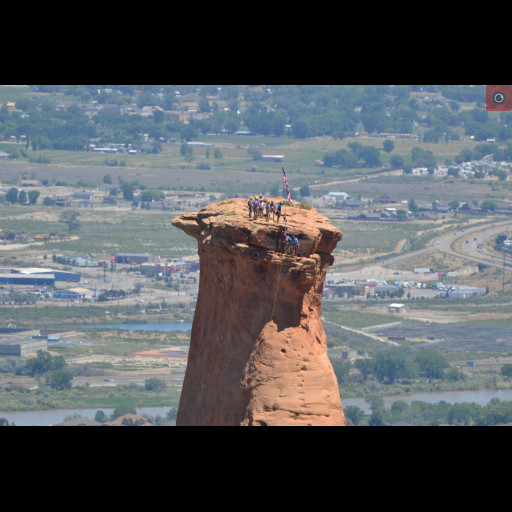 Mesa County Search and Rescue raising the flag atop of Independence Monument