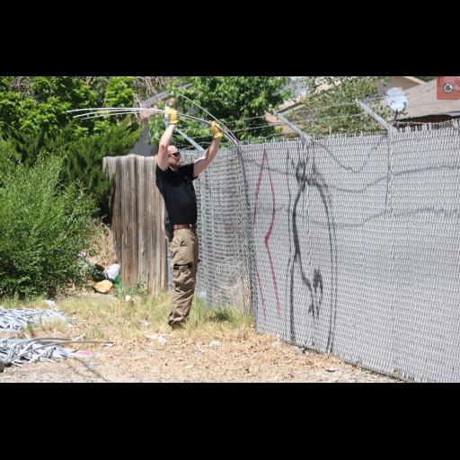 Wildland Firefighter removing graffiti